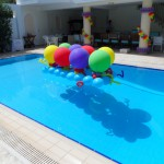 Colourful outdoors pool balloon decorations